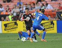Alain Rochat (25) of D.C. United goes against Sam Cronin (4) of the San Jose Earthquakes.  D.C. United defeated the San Jose Earthquakes 1-0, at RFK Stadium, Saturday June 22 , 2013.