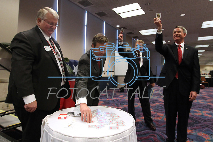 Dave Buell, left, with the Nevada Republican State Central Committee, watches congressional candidates, from left, Greg Brower, Mark Amodei and Kirk Lippold draw cards to determine their speaking order during a special meeting Saturday, June 18, 2011 in Reno, Nev. The committee chose Amodei as their party candidate in the upcoming special election. .Photo by Cathleen Allison