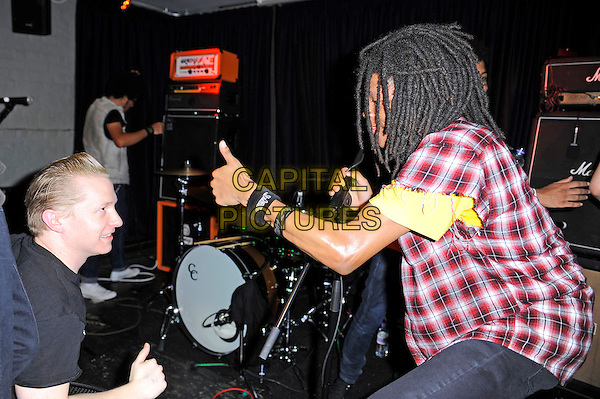 Dee Radke of Radkey <br /> performing in concert, The Blackeart, Camden, London, England. <br /> 17th October 2013<br /> on stage in concert live gig performance performing music half length red check shirt yellow top guitar side profile hand thumb up   <br /> CAP/MAR<br /> &copy; Martin Harris/Capital Pictures