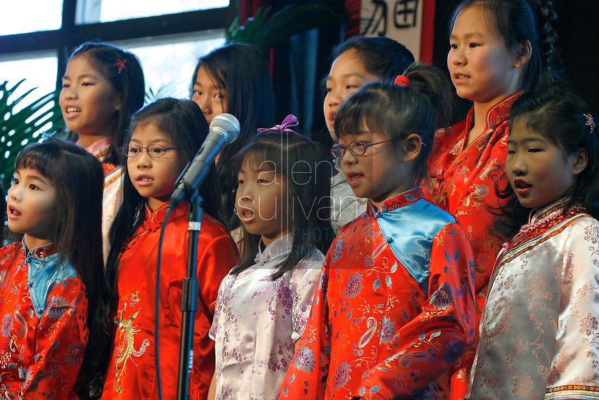 A group of young singers performs a traditional Chinese song during a ceremony to announce the name of Zoo Atlanta?s giant panda cub. ?Mei Lan,? which translates to ?Atlanta Beauty? won in an online poll, receiving 22% of the 57,015 votes cast. Voters were given a list of 10 names from which to choose. The names were suggested by several institutions interested in panda conservation including local media, Zoo Atlanta staff and volunteers, Panda Express (a Zoo Atlanta sponsor) and the people of China.<br />