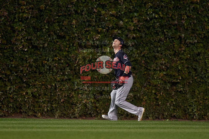 Cleveland Indians center fielder Tyler Naquin (30) gets under a fly ball in the first inning during Game 4 of the Major League Baseball World Series against the Chicago Cubs on October 29, 2016 at Wrigley Field in Chicago, Illinois.  (Mike Janes/Four Seam Images)