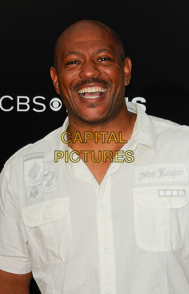 "MAURICE GREENE .arriving at the premiere of CBS Films' ""The Back-up Plan"" at the Regency Village Theatre in Westwood, California, USA, April 21st 2010..arrivals portrait headshot white shirt smiling moustache mustache facial hair .CAP/ROT.©Lee Roth/Capital Pictures"