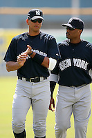 February 25, 2009:  Third baseman Alex Rodriguez (13) and second baseman Robinson Cano (24) of the New York Yankees during a Spring Training game at Dunedin Stadium in Dunedin, FL.  The New York Yankees defeated the Toronto Blue Jays 6-1.   Photo by:  Mike Janes/Four Seam Images