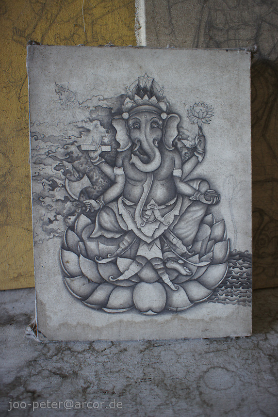 traditional balinese ink painting of god Ganesha, made with Bamboo stick, village Mas, Bali, archipelago Indonesia, 2010. The ink painting is several years old, but in incomplete state, showing process of painting.
