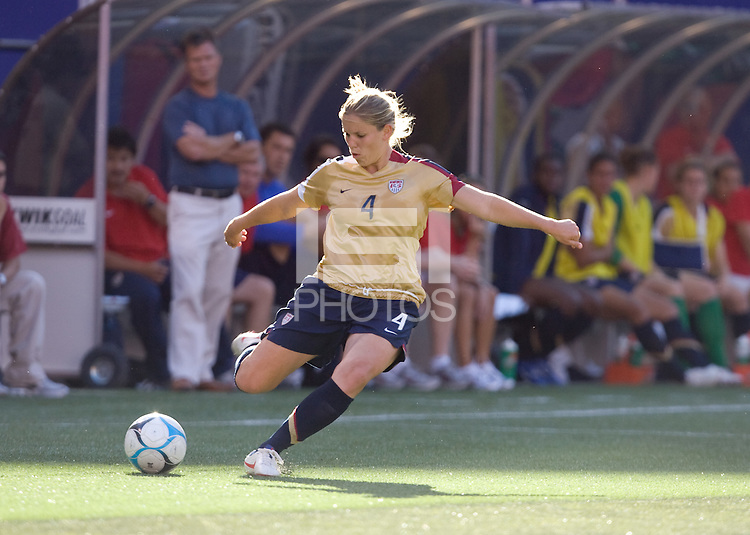 Cat Whitehill hits a cross in front of head coach Greg Ryan and the USA bench. USA defeated Brazil 2-0 at Giants Stadium on Sunday, June 23, 2007.