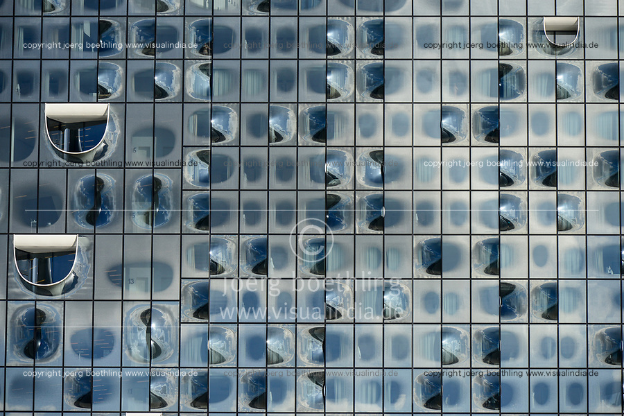 Germany, Hamburg, glass facade of concert hall Elbphilharmonie, woman get dressed in bathroom of Hotel The Westin