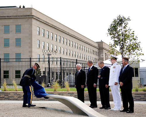 United States Secretary of Defense Robert Gates,  eft, U.S. President George W. Bush, second left,  Donald Rumsfeld, former U.S. Secretary of Defense, center, Admiral Michael Mullen, chairman of the Joint Chiefs of Staff, second right and James Laychak, chairman of the board of the Pentagon Memorial Fund watch as a bench is unveiled at the dedication of the September 11th Memorial at the Pentagon on the 7th anniversary of the September 11, 2001 attacks on New York and Washington in Washington, DC, Thursday, September 11, 2008.<br /> Credit: Joshua Roberts / Pool via CNP