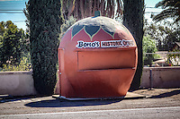 The Big Orange, a 7-foot tall orange-shaped citrus stand, is located on the property of Bono's restaurant. The orange was originally located 3 miles to the east; restaurant owner Joe Bono purchased the stand in the 1990s and moved it to its current site. While the restaurant had an orange-shaped stand of its own when it served Route 66 traffic, it was eventually demolished due to decreased demand. The Big Orange is one of six surviving orange-shaped buildings in California.