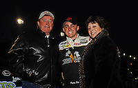 Apr 16, 2009; Avondale, AZ, USA; NASCAR Camping World Series West driver Austin Dillon (center) is surrounded by car owner Richard Childress (left) and wife Judy Childress prior to the Jimmie Johnson Foundation 150 at Phoenix International Raceway. Mandatory Credit: Mark J. Rebilas-