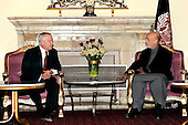 Kabul, Afghanistan - December 8, 2009 -- United States Secretary of Defense Robert M. Gates talks with Afghan President Hamid Karzai  at the presidential palace in Kabul, Afghanistan Tuesday, December 8, 2009. Secretary Gates is on his first trip back to southwest Asia after President Obama agreed to send an additional 30,000 troops to Afghanistan. .Mandatory Credit: Jerry Morrison - DoD via CNP