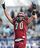 Glen Cove lineman No. 70 Mike Puetzer reacts after his team's 21-0 win over Bethpage in a Nassau County varsity football Conference III semifinal at Hofstra University on Saturday, Nov. 14, 2015. <br /> <br /> James Escher