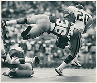 Ohio State's Chris Spielman (36) leaps over teammate Ray Jackson (47) in route to tackling West Virginia's Craig Taylor (20) September 12, 1987. (Dispatch photo by Mike Munden)