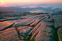 Granite on the summit of Cadillac Mountain<br />   and Otter Point at sunrise<br /> Acadia National Park<br /> Mount Desert Island,  Maine