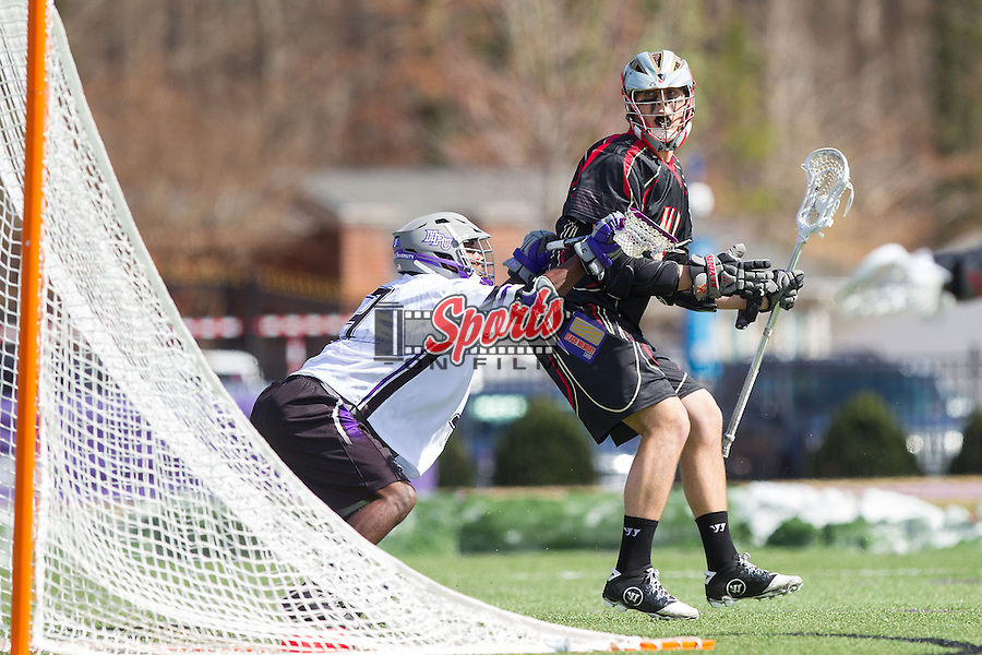 Ben Huger (40) of the VMI Keydets is checked by Richard Byrd (3) of the High Point Panthers at Vert Track, Soccer & Lacrosse Stadium on March 8, 2014 in High Point, North Carolina.  The Panthers defeated the Keydets 9-8.   (Brian Westerholt/Sports On Film)