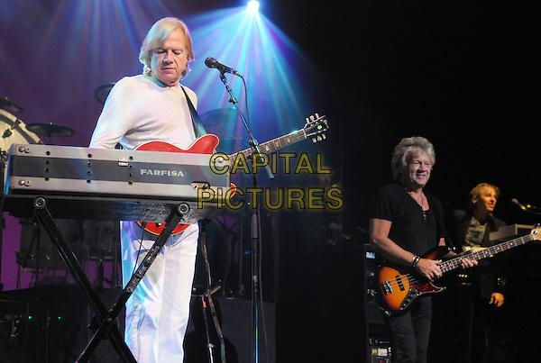 THE MOODY BLUES.Musicians Justin Hayward & John Lodge of The Moody Blues performs onstage at Hamilton Place during the 2010 Tour, Hamilton, Ontario, Canada..July 5th, 2010.stage concert live gig performance music half length white top full 3/4 keyboards guitar bass black.CAP/ADM/BPC.©Brent Perniac/AdMedia/Capital Pictures.