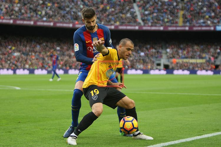 League Santander 2016/2017. Game: 12.<br /> FC Barcelona vs Malaga CF: 0-0.<br /> Gerard Pique vs Sandro Ramirez.