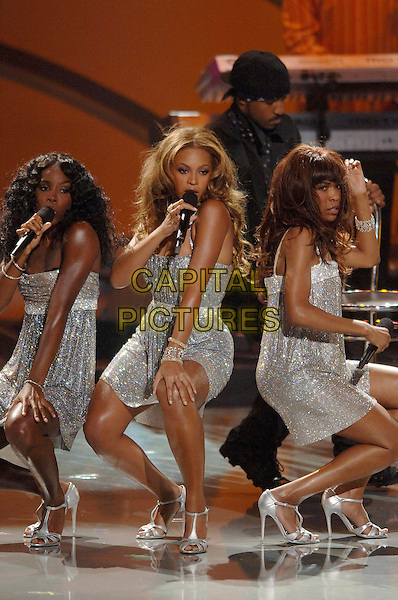 KELLY ROWLAND, BEYONCE KNOWLES & MICHELLE WILLIAMS, (DESTINY'S CHILD).Perform at The World Music Awards-Show held at the Kodak Theatre,.Hollywood, 31st  August 2005.full length stage gig concert silver sequin sparkly dress microphone singing dancing.www.capitalpictures.com.sales@capitalpictures.com.© Capital Pictures.