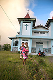 INDONESIA, Flores, kids in front of a church at Saga Village