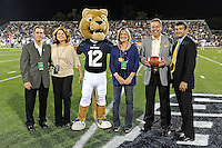 1 October 2011:  FIU Athletic Director Pete Garcia presents the game ball at the end of the first quarter.  The Duke University Blue Devils defeated the FIU Golden Panthers, 31-27, at FIU Stadium in Miami, Florida.