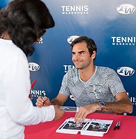 ROGER FEDERER (SUI) SIGNING AUTOGRAPHS AT TENNIS WAREHOUSE <br /> <br /> BNP PARIBAS OPEN, INDIAN WELLS, TENNIS GARDEN, INDIAN WELLS, CALIFORNIA, USA<br /> <br /> &copy; TENNIS PHOTO NETWORK