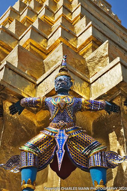 A guardian demon at a golden stupa at the Grand Palace in Ko Rattanakosin in Bangkok.