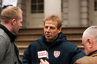 U.S. men's head coach Jurgen Klinsmann is interviewed at a press conference honoring the centennial of U. S. Soccer at City Hall in New York, NY, on April 05, 2013.
