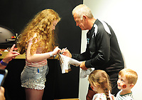 A Swansea city fan gets the signature of Alan Curtis  Swansea city's Assistant Coach during the Swansea City Training at The Liberty Stadium, Swansea, Wales, UK. Tuesday 07 August 2018
