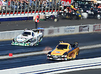 Nov. 10, 2012; Pomona, CA, USA: NHRA funny car driver Jeff Arend (near lane) races alongside Mike Neff during qualifying for the Auto Club Finals at at Auto Club Raceway at Pomona. Mandatory Credit: Mark J. Rebilas-