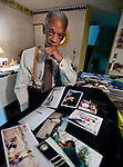Photo by Phil Grout..John Milton Wesley of Columbia lost his fiancee, Sarah Clark, who was aboard Flight 77 which was hijacked on September 11, 2001 and flown into the Pentagon.  He looks over his collection of favorite photographs of Sarah...