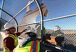 "A Q&D Construction crew installs ""cattle drive image panels"" on the Fairview overpass above the Highway 395 bypass on Monday afternoon in Carson City. The work is part of the Carson City Freeway Landscape Project that includes landscape, art and history along the freeway corridor..Photo by Cathleen Allison"