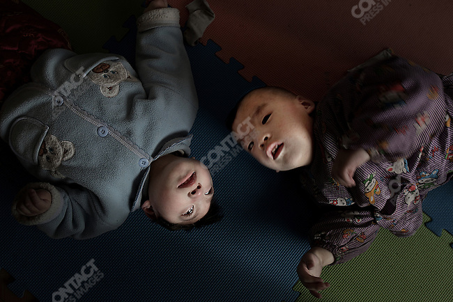 A growing number of benevolent care homes help abandoned babies born with defects, in Shanxi Province. April 14, 2009.