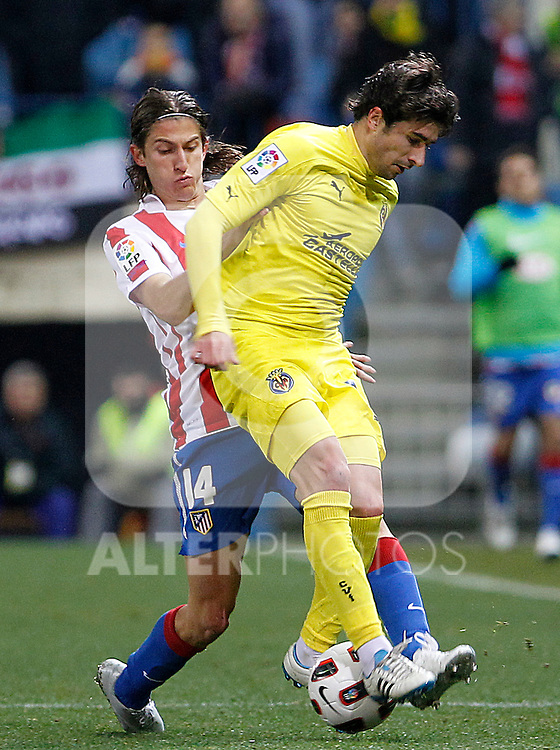 Villareal's Cani (r) and Atletico de Madrid's Filipe Luis during La Liga match.March 5,2011. (ALTERPHOTOS/Acero)