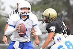 Palos Verdes, CA 09/16/11 - Lukas O'Connor (Culver City #3) and unidentified Peninsula player(s) in action during the Culver City-Peninsula varsity football game.