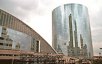 Paris: La Defense--CNIT (National Center for Industry and Technology). Left, 1958, and new Bull (1990?) building. Conference and exhibit center. Photo '90.