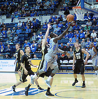 December 12, 2015 - Colorado Springs, Colorado, U.S. -  Air Force guard, Trevor Lyons #20, drives for a layup during an NCAA basketball game between the Army West Point Black Knights and the Air Force Academy Falcons at Clune Arena, U.S. Air Force Academy, Colorado Springs, Colorado.  Army West Point defeats Air Force 90-80.