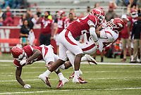 Hawgs Illustrated/BEN GOFF <br /> Deon Edwards, Arkansas linebacker, tackles running back Jemarcus Arnold in the third quarter Saturday, April 6, 2019, during the Arkansas Red-White game at Reynolds Razorback Stadium.