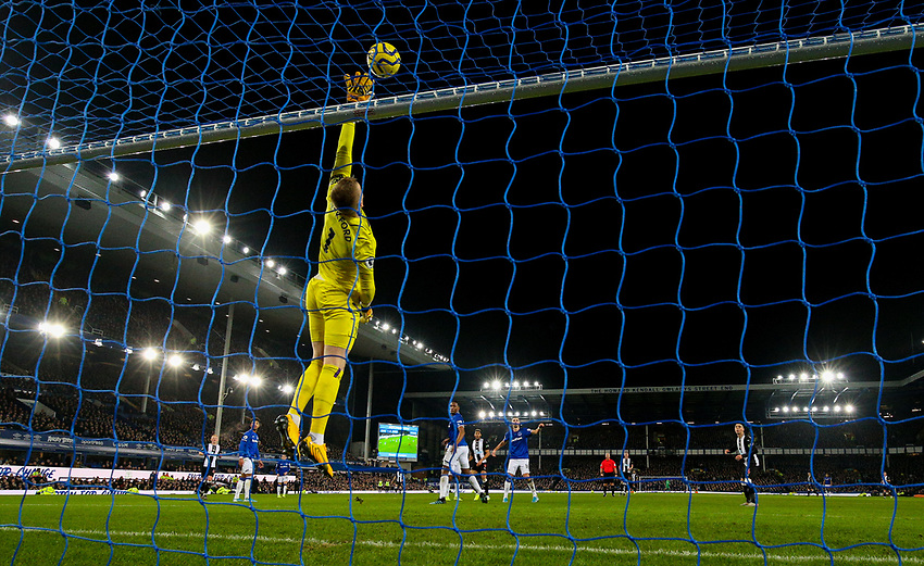 Everton's Jordan Pickford watches Newcastle United's Miguel Almiron's shot go over the bar<br /> <br /> Photographer Alex Dodd/CameraSport<br /> <br /> The Premier League - Everton v Newcastle United  - Tuesday 21st January 2020 - Goodison Park - Liverpool<br /> <br /> World Copyright © 2020 CameraSport. All rights reserved. 43 Linden Ave. Countesthorpe. Leicester. England. LE8 5PG - Tel: +44 (0) 116 277 4147 - admin@camerasport.com - www.camerasport.com