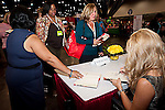 Conference speaker Leigh Anne Tuohy signs her book at the Texas Conference for Women 2010. Your Time is Now!