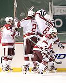 The Minutemen celebrate Eric Filiou's (UMass - 10) goal. - The University of Massachusetts (Amherst) Minutemen defeated the University of Vermont Catamounts 3-2 in overtime on Saturday, January 7, 2012, at Fenway Park in Boston, Massachusetts.