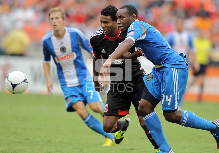 WASHINGTON, D.C. - AUGUST 19, 2012:  Lionard Pajoy (26) of DC United races for the ball with Amobi Okugo (14) of the Philadelphia Union during an MLS match at RFK Stadium, in Washington DC, on August 19. The game ended in a 1-1 tie.