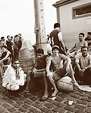 Brazil, Belem, South America, group of basket makers sitting together by stack of baskets (B&W)