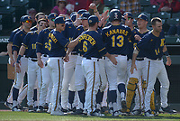 NWA Democrat-Gazette/ANDY SHUPE<br />Kent State right fielder Nick Kanavas (13) is congratulated at the plate Friday, March 9, 2018, after hitting a solo home run against Arkansas during the first inning at Baum Stadium in Fayetteville. Visit nwadg.com/photos to see more photographs from the game.