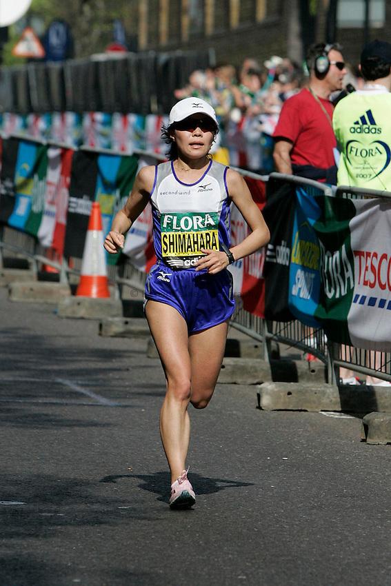 Japan's Kiyoko Shimahara trails the elite women's pack slightly as she runs along The Highway.