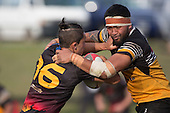 Jackson Orr tries to fight his way free from Peter Vea's tackle. Counties Manukau Premier Club rugby game between Te Kauwhata and Onewhero, played at Te Kauwhata on Saturday April 16th 2016. Onewhero won the game 37 - 0 after leading 13 - 0 at Halftime. Photo by Richard Spranger.