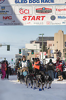 Lev Shvarts and team leave the ceremonial start line with an Iditarider at 4th Avenue and D street in downtown Anchorage, Alaska on Saturday March 2nd during the 2019 Iditarod race. Photo by Brendan Smith/SchultzPhoto.com