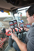In-cab view operating a Grimme Varitron 220 potato harvester