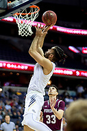 Washington, DC - MAR 7, 2018: George Washington Colonials forward Arnaldo Toro (11) goes up for a layup in game between G.W. and Fordham during first round action of the Atlantic 10 Basketball Tournament at the Capital One Arena in Washington, DC. (Photo by Phil Peters/Media Images International)