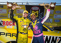 Oct 16, 2016; Ennis, TX, USA; NHRA funny car driver Matt Hagan (left) and top fuel teammate Antron Brown celebrate after winning the Fall Nationals at Texas Motorplex. Mandatory Credit: Mark J. Rebilas-USA TODAY Sports