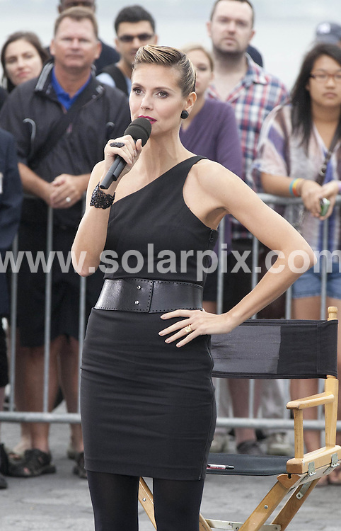 """**ALL ROUND PICTURES FROM SOLARPIX.COM**                                             **SYNDICATION RIGHTS FOR UK, AUSTRALIA, DENMARK, PORTUGAL, S. AFRICA, SPAIN & DUBAI (U.A.E) & ASIA (EXCLUDING JAPAN) ONLY**                                                                                  Caption:  Kim Kardashian, Nina Garcia, Michael Kors, Heidi Klum - """"Project Runway"""" Filming at Battery Park in New York City on June 24, 2011 - Battery Park - New York City, NY, USA                                                                             This pic:  Heidi Klum                                                                                             JOB REF: 13614       PHZ       DATE: 24.06.2011                                                           **MUST CREDIT SOLARPIX.COM OR DOUBLE FEE WILL BE CHARGED**                                                                      **MUST AGREE FEE BEFORE ONLINE USAGE**                               **CALL US ON: +34 952 811 768 or LOW RATE FROM UK 0844 617 7637**"""