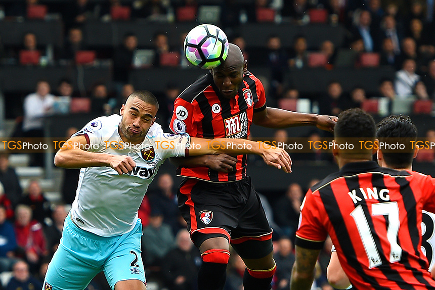 Benik Afobe of AFC Bournemouth wins a header from Winston Reid of West Ham United during AFC Bournemouth vs West Ham United, Premier League Football at the Vitality Stadium on 11th March 2017